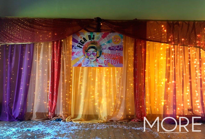 1970's theme warm white fairy light curtain backdrop with coloured drape