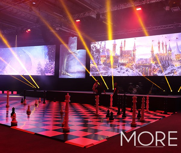 Black and white dance floor with chess pieces Alice in Wonderland theme event