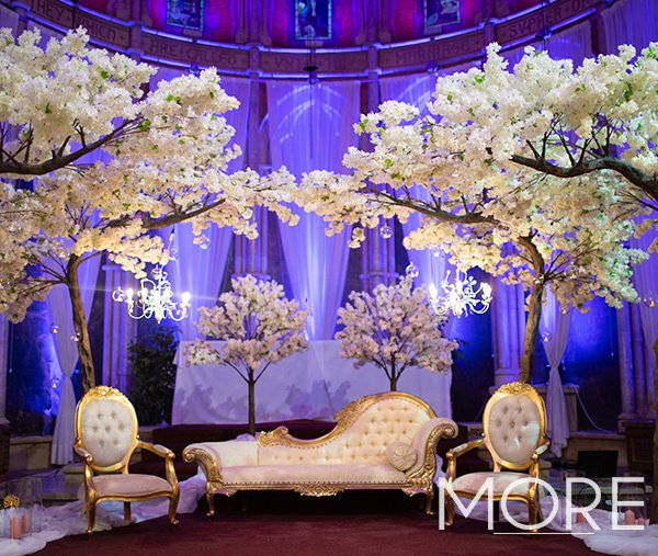 Blossom Trees and ornate furniture Empire Hall wedding