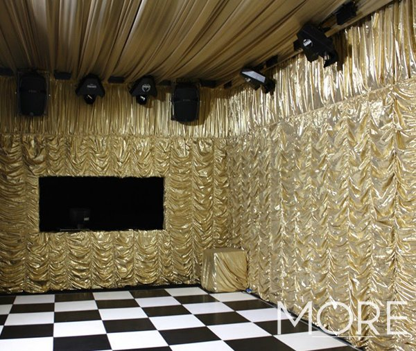Gold cabaret wall drape