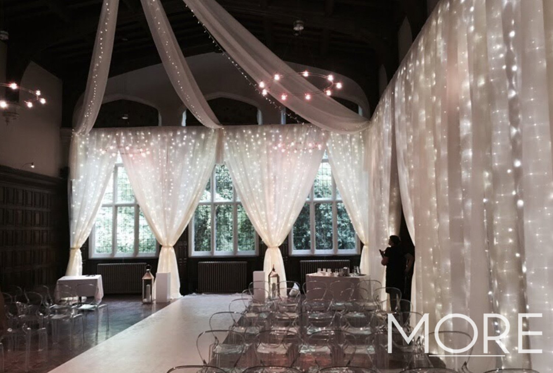 Bright white fairy light curtain wedding