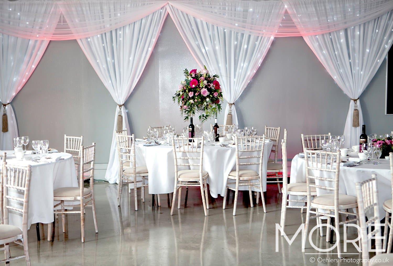 Bright white fairy light curtain Ladywood Estate wedding