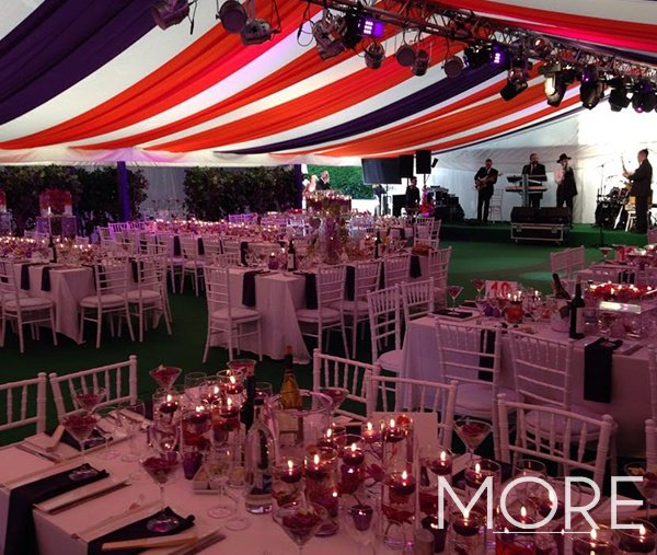 red and blue linear marquee ceiling drapes