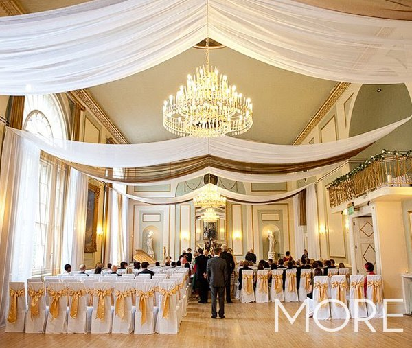 white and gold linear wedding ceiling drapes