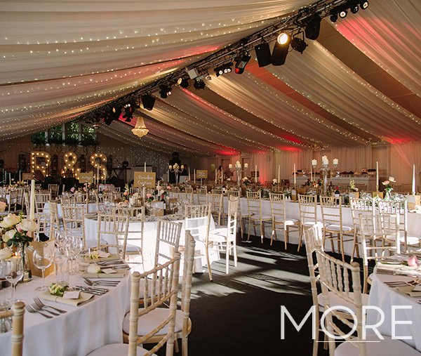 white linear ceiling drapes with fairy lights marquee wedding