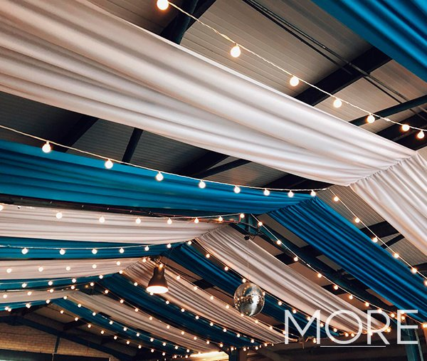 Oktoberfest blue and white linear ceiling drapes with festoon canopy