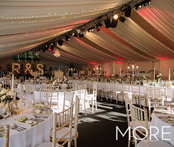 Linear fairy light canopy with ceiling drapes marquee wedding