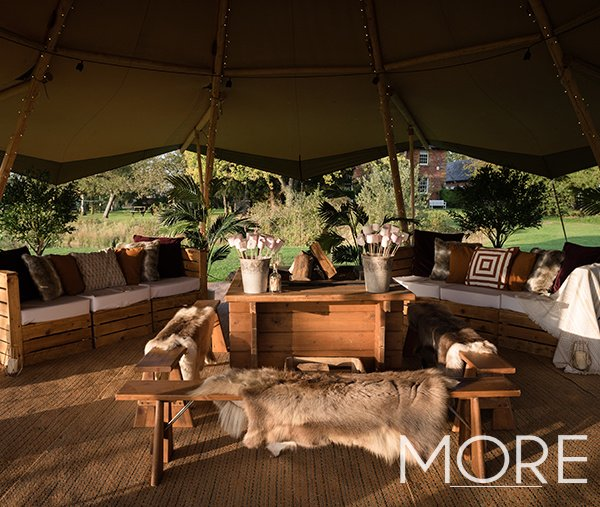 Tipi wedding with rustic pallet furniture