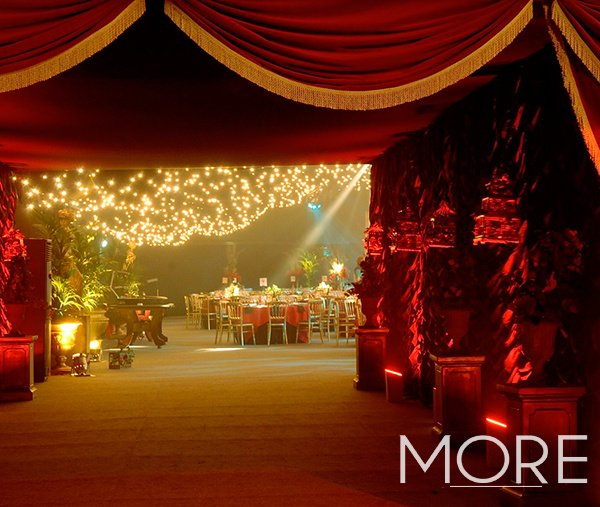 Red pelmet drape with gold tassel Moulin Rouge theme