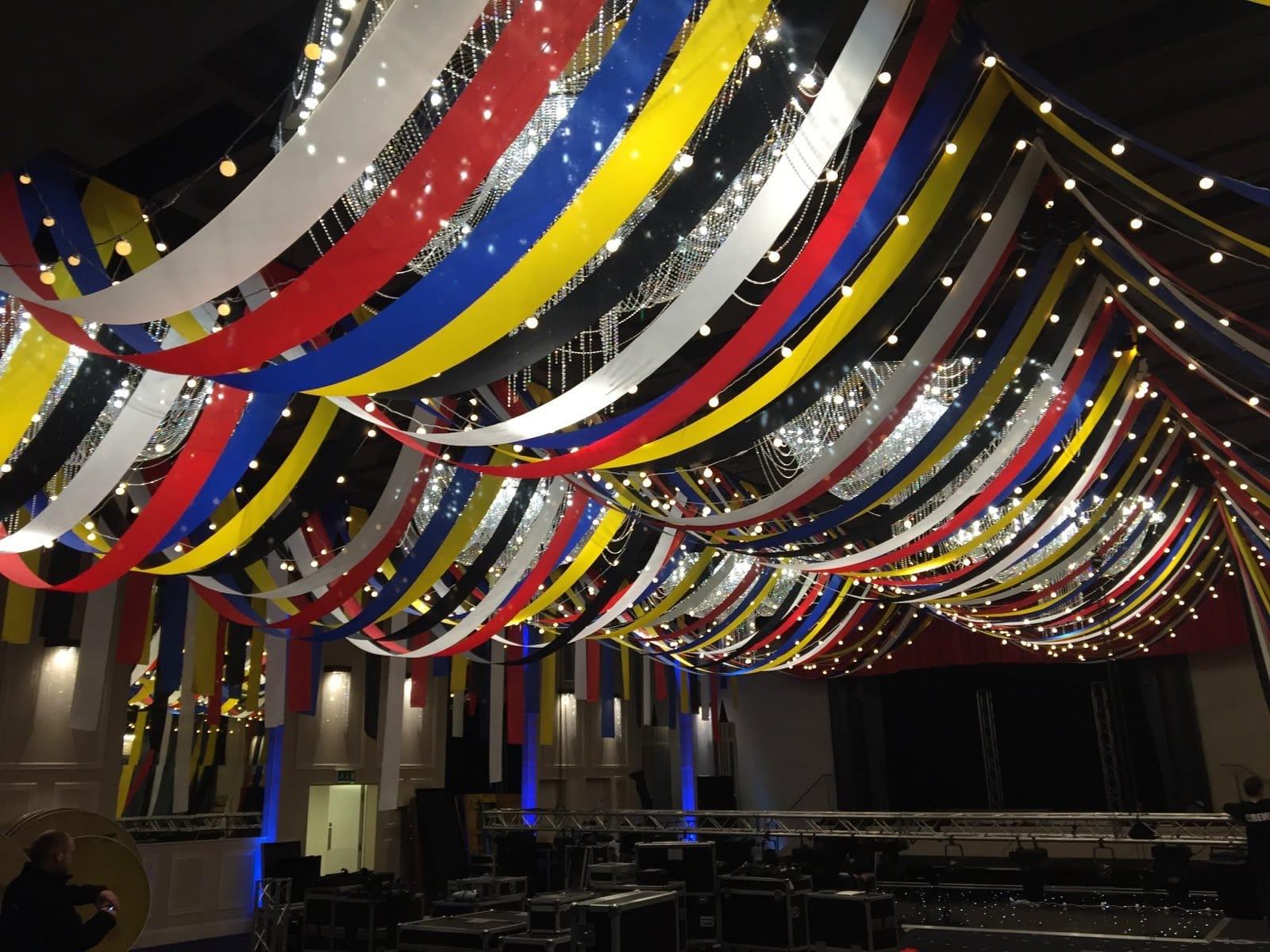 Festival theme streamer ceiling installation