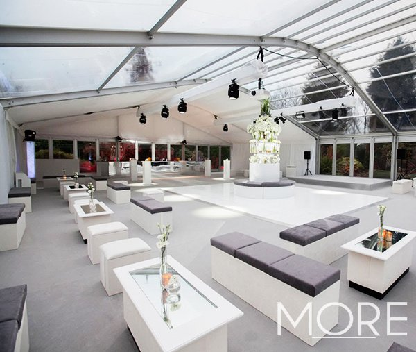 Marquee wedding decor with white and grey furniture