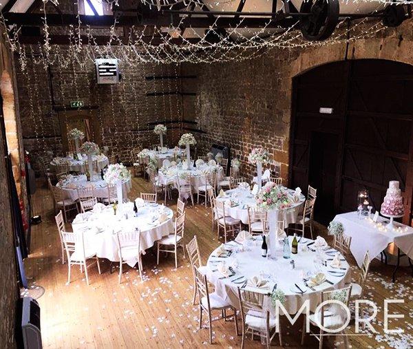 Barn wedding decor with fairy light canopy