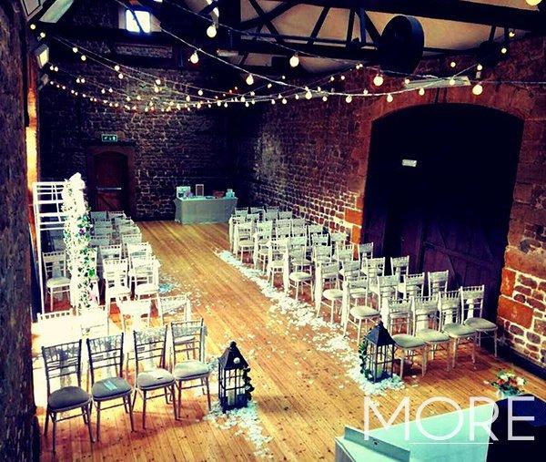 Barn wedding decor with festoon canopy