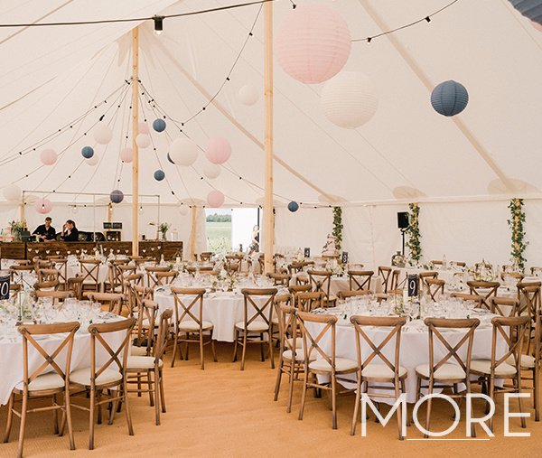 Marquee wedding decor with festoon canopy and hanging paper lanterns