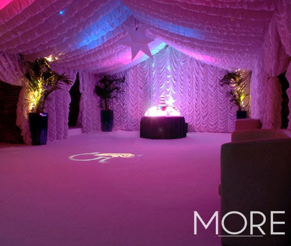 white cabaret ceiling and wall drapes