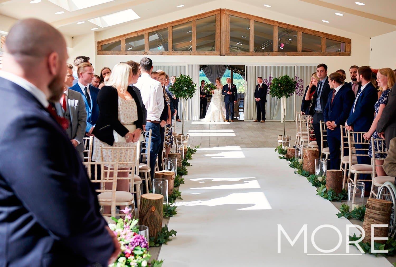Ladywood Estate rustic wedding with white carpet aisle
