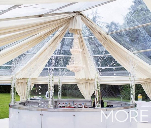White radial ceiling drapes with crystal empire chandelier marquee wedding