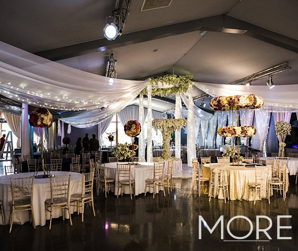 Ladywood Estate wedding decor with white radial ceiling drapes and blossom chandelier