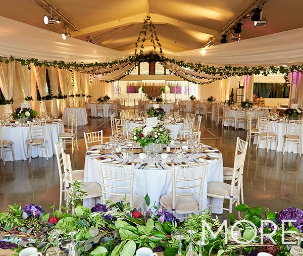 Ladywood Estate wedding decor with white radial ceiling drapes and foliage chandelier