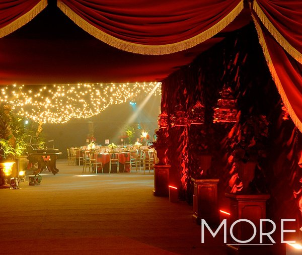 Moulin Rouge theme red cabaret wall drape with red and gold tassel pelmet