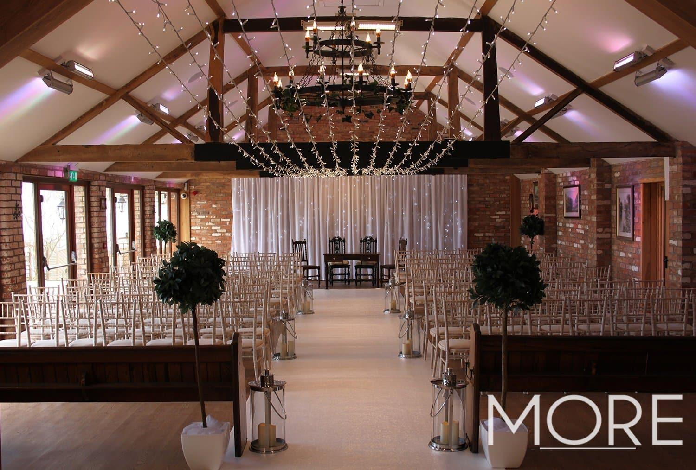 Keythorpe Manor white carpet wedding aisle with fairy light canopy